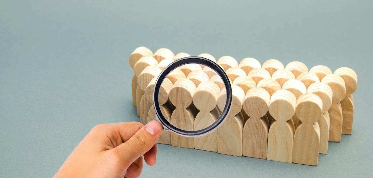 Wooden figures representing audience targeting