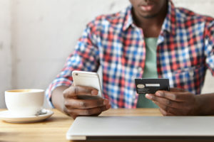 Man making payment online via cell phone