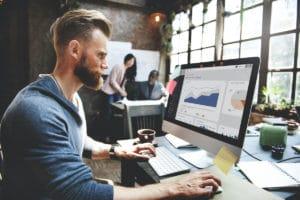 Digital marketer looking at key metrics in a report